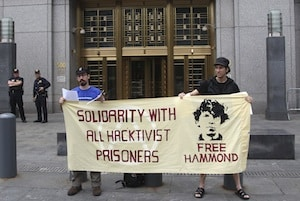 Protesters stand in front of the federal courthouse during the arraignment of Jeremy Hammond in Manhattan on May 14, 2012. (Photo: AP Photo/Seth Wenig)