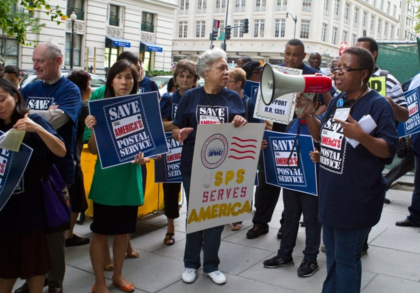 Representatives of the American Postal Workers Union, pictured here at a 2011 protest, have rallied in support of a postal banking system. (Mark Taylor / Flickr / Creative Commons)