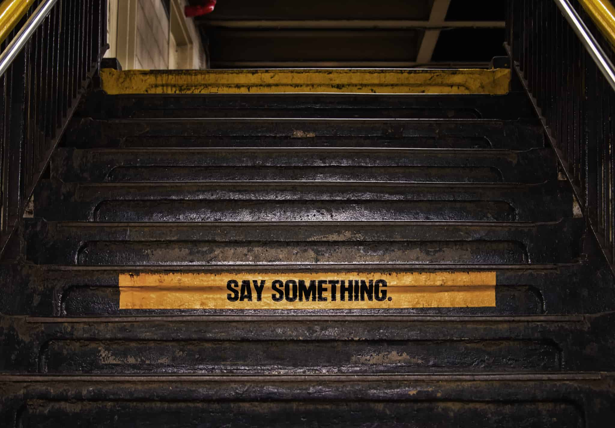 Security warning on the stairs in the NYC subway. (flickr/cc Russ Allison Loar)