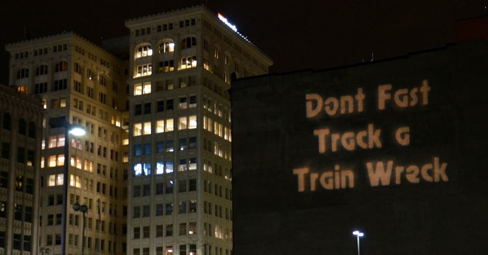 Projected on the side of a building in Spokane, Washington in 2013, the message against 'fast track' authority, which would restrict lawmakers ability to weigh in or make changes to the deal, has been key in the fight against the Trans-Pacific Trade Partnership agreement. The reason: If the American people knew what was in this deal they would never allow their members of Congress to vote in favor of it. (Photo: Michael Beasley of Spokane Coalition Builders/flickr/cc)