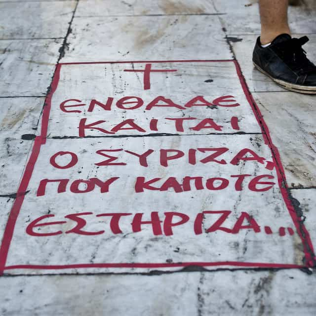 """Here lies SYRIZA, that i once supported"" written on the pavement of Syntagma Square. (photo: Chris Acos @ flickr.cc)"