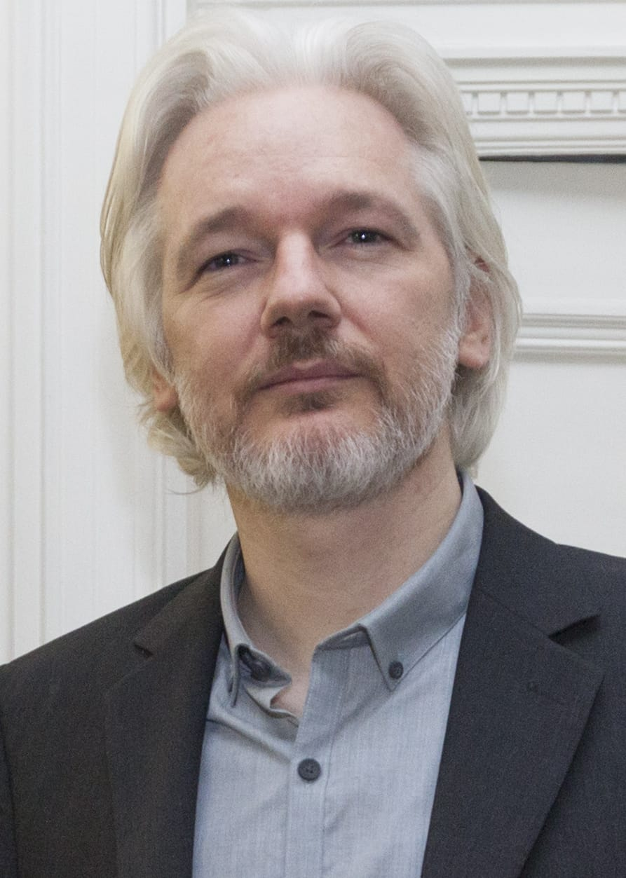 "Assange in the Ecuadorian Embassy, London (Photo:  ""Julian Assange August 2014"" by David G Silvers. - https://www.flickr.com/photos/dgcomsoc/14770416197/. Licensed under CC BY-SA 2.0 via Commons - https://commons.wikimedia.org/wiki/File:Julian_Assange_August_2014.jpg#/media/File:Julian_Assange_August_2014.jpg)"