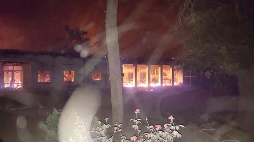 Fires burn in the MSF emergency trauma hospital in Kunduz, Afghanistan, after it was hit and partially destroyed by missiles 03 October 2015. (Photo msf.org)