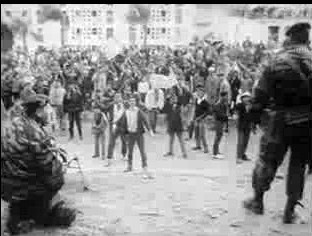 National Liberation Front muslim supporters face to face with French paratroopers during the December 10 1960 protest.