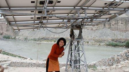 Students' Educational and Cultural Movement of Ladakh, India installing solar panels at a school. Photo: Kiran Jonnalagadda - Flickr - CC 2.0