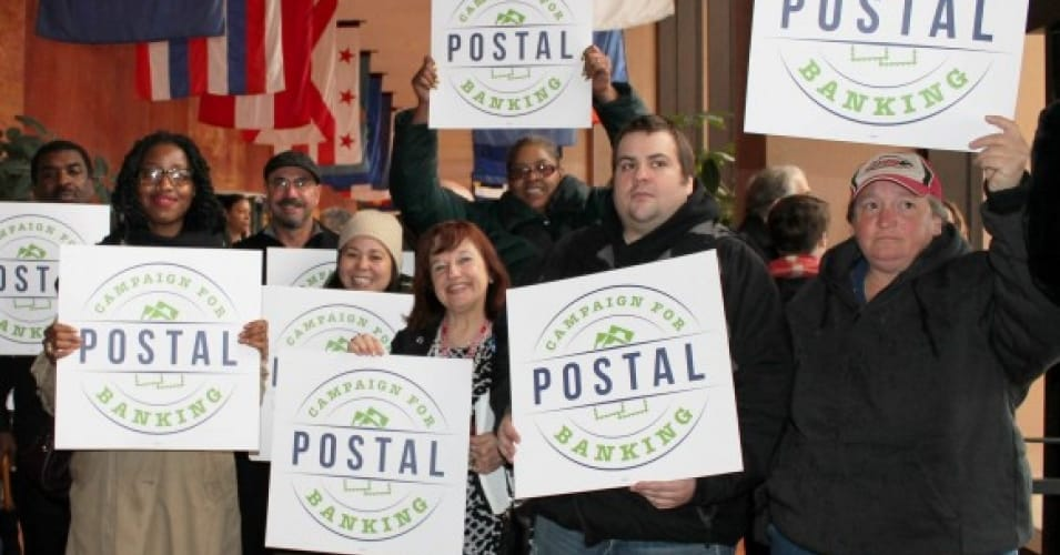 Members of the Campaign for Postal Banking delivered more than 150,000 signatures on a petition to the U.S. Postal Service headquarters in December 2015. (Photo via Inequality.org)