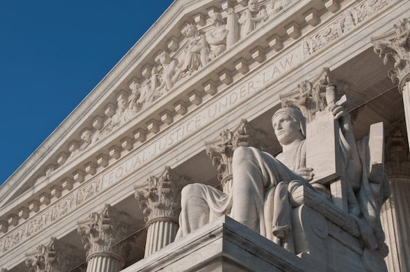 """The Guardian,"" or ""Authority of Law,"" sits in front of the Supreme Court building in Washington, D.C. (Mark Fischer / CC BY-SA 2.0)"