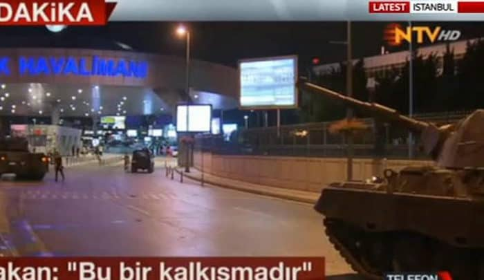 News report showing tanks approaching Istanbul's Atatürk Airport
