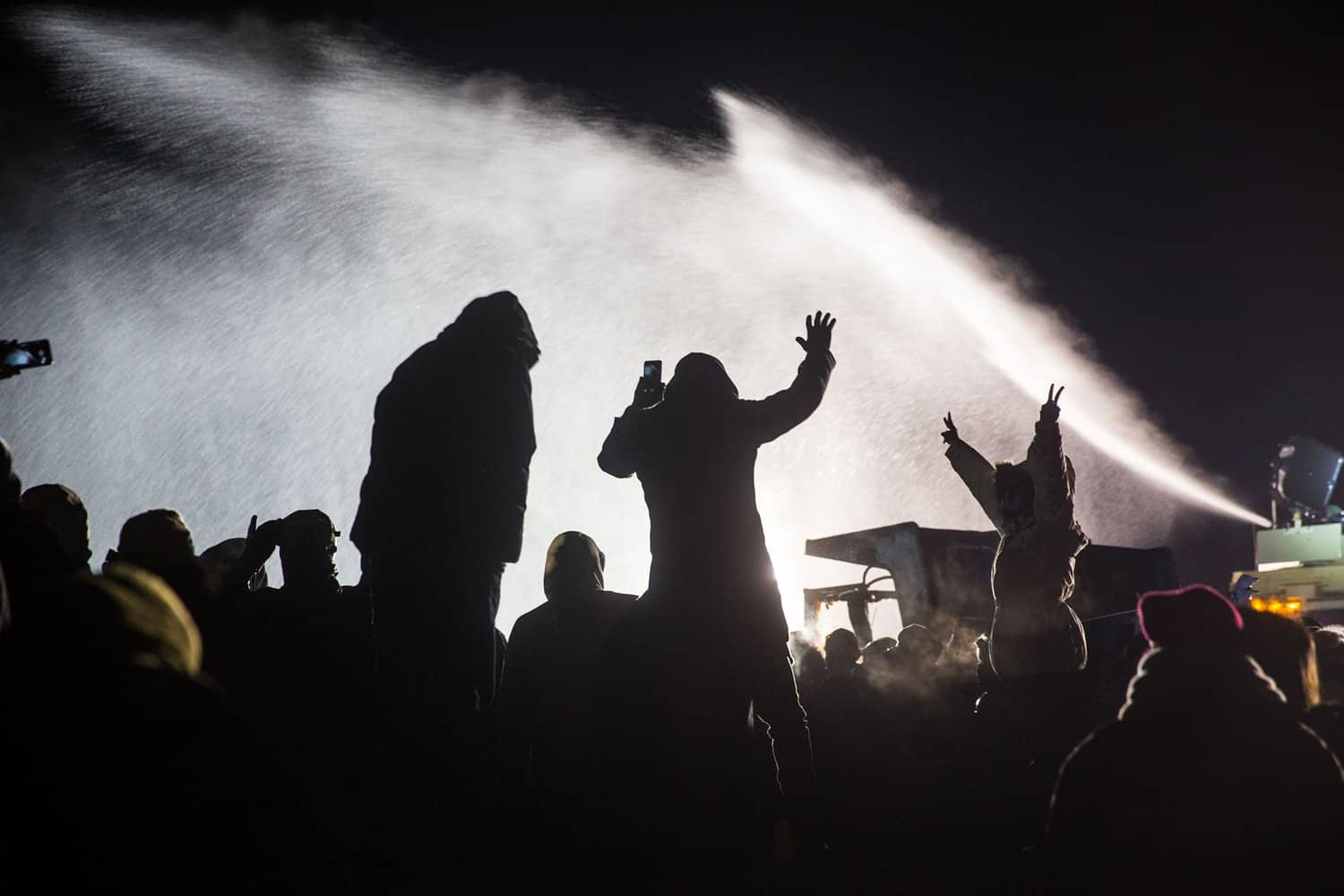 Water Cannons Fired at Water Protectors in Freezing Temperatures Injure Hundreds. (Photo by Sacred Stone Camp)