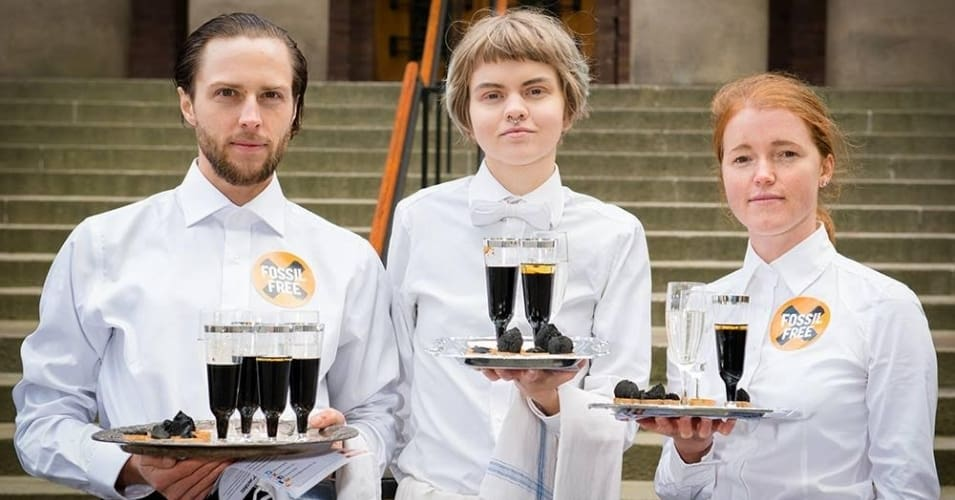 Members of Divest Nobel served oil drinks outside the Royal Swedish Academy of Sciences in Stockholm where the 2016 Physics Prize was announced on 4th October. (Photo: Divest Nobel)